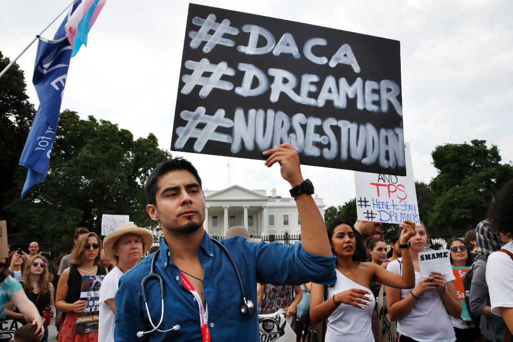 Carlos Esteban, 31, of Woodbridge, Va., a nursing student and recipient of Deferred Action for Childhood Arrivals, known as DACA, rallies with others in support of DACA outside of the White House, in Washington on Tuesday. President Donald Trump will end a program that has protected hundreds of thousands of young immigrants brought into the country illegally as children and call for Congress to find a legislative solution.