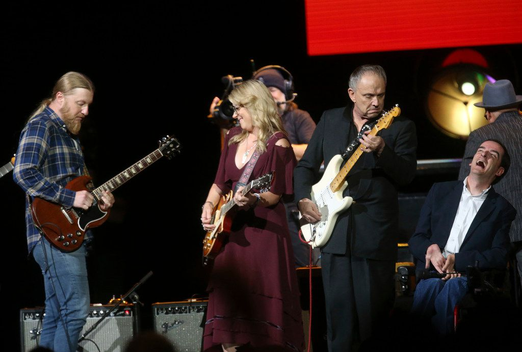 (from left) Derek Trucks, Susan Tedeschi, Jimmie Vaughan, of Dallas, and singer Bradley Walker take part in a group finale during the Crossroads Guitar Festival on Saturday, Sept. 22, 2019 at the American Airlines Center in downtown Dallas. The concert put together by Eric Clapton, which benefits his Crossroads addiction recovery center, took place over two nights with different performers each night. (Michael Hamtil/The Dallas Morning News)