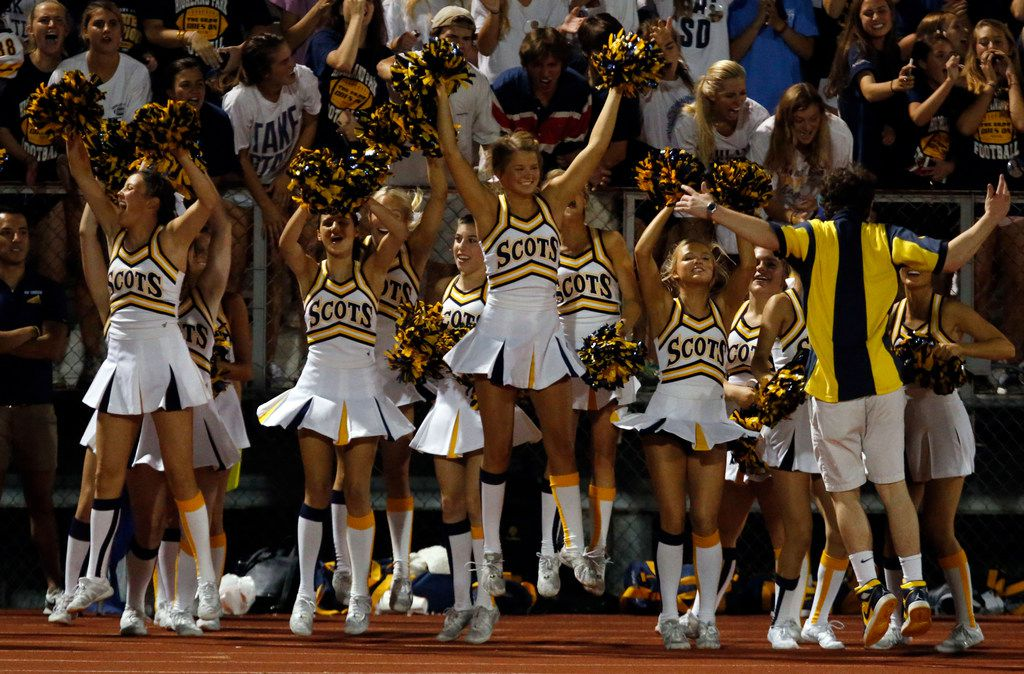 The Highland Park High cheerleaders jump for joy as the team scores and ties up the score during the first half of the team's game against Rockwall high in a football game at Wilkerson-Sanders Stadium in Rockwall on Friday, August 30, 2019. (John F. Rhodes / Special Contributor)