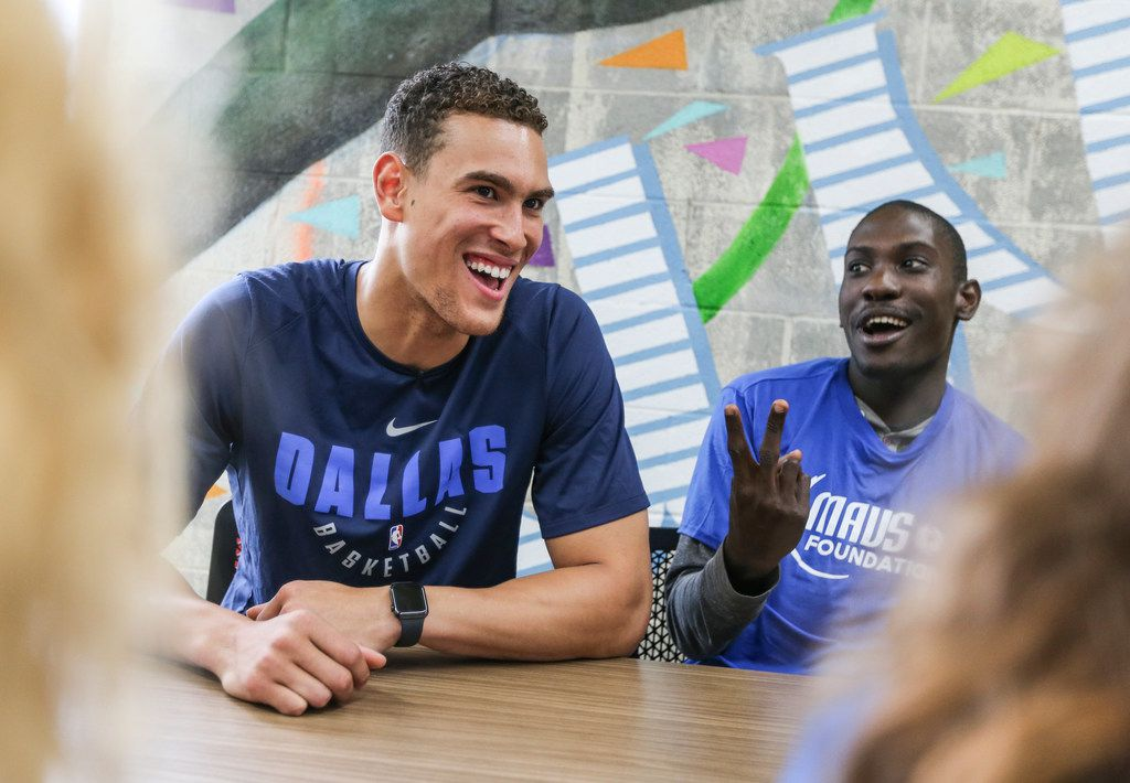 Dwight Powell (left) jokes with John Callaway, of Dallas, as the Mavs Foundation, the nonprofit arm of the Dallas Mavericks, unveils a new Mavs Tech Center in CitySquare's newly renovated Fannie. C Harris Youth Drop In Center to serve former foster youth ages 16-24, along with all homeless youth in the Dallas ISD, on Tuesday, June 4, 2019 in Dallas. (Ryan Michalesko/The Dallas Morning News)