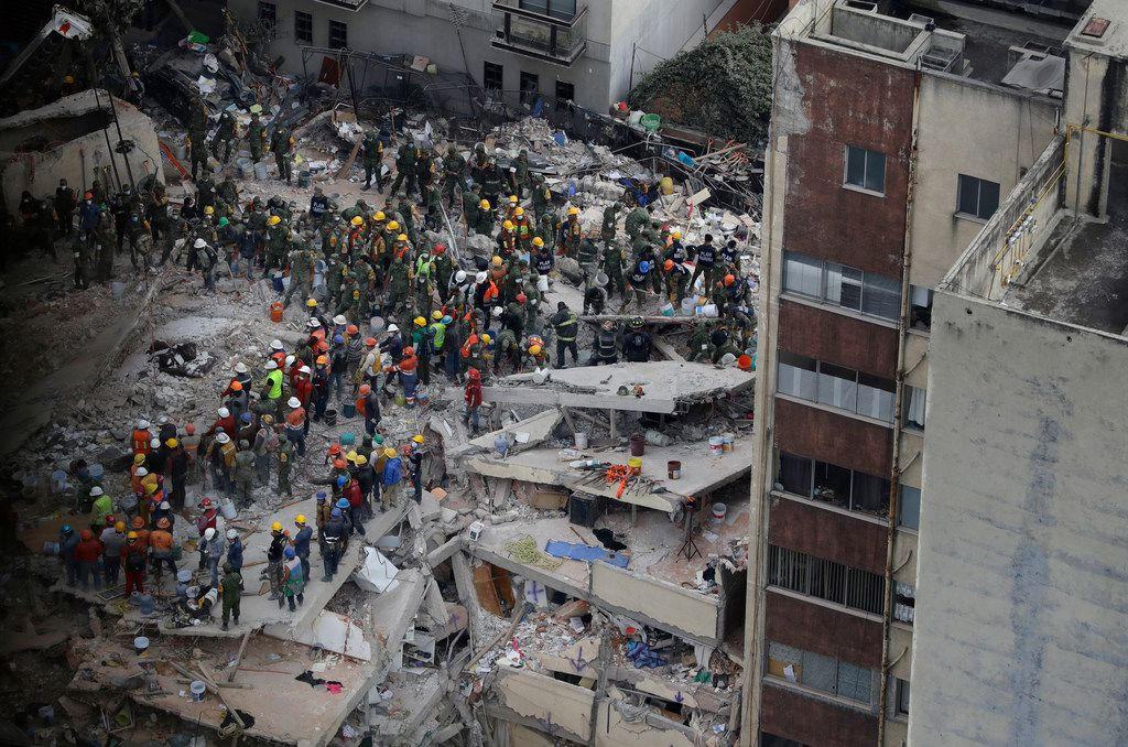 Rescue workers search for people trapped inside a collapsed building in the Del Valle area of Mexico City.