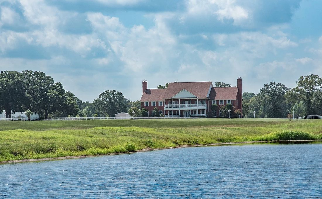 The 12,000-square-foot house near Grand Saline overlooks a private lake.