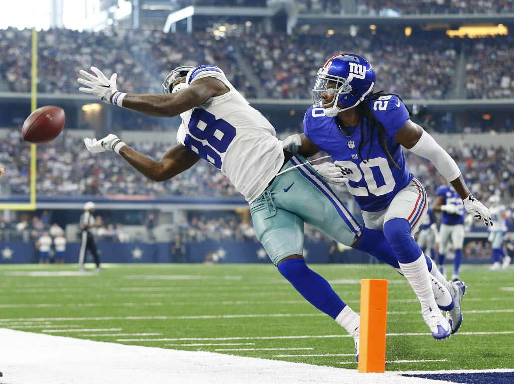 Dallas Cowboys wide receiver Dez Bryant (88) reaches for a Dak Prescott pass that carried him out of bounds as he was covered by New York Giants defensive back Janoris Jenkins (20) in the fourth quarter at AT&T Stadium in Arlington, Texas, Sunday, September 11, 2016. The Cowboys lost 20-19. (Tom Fox/The Dallas Morning News)