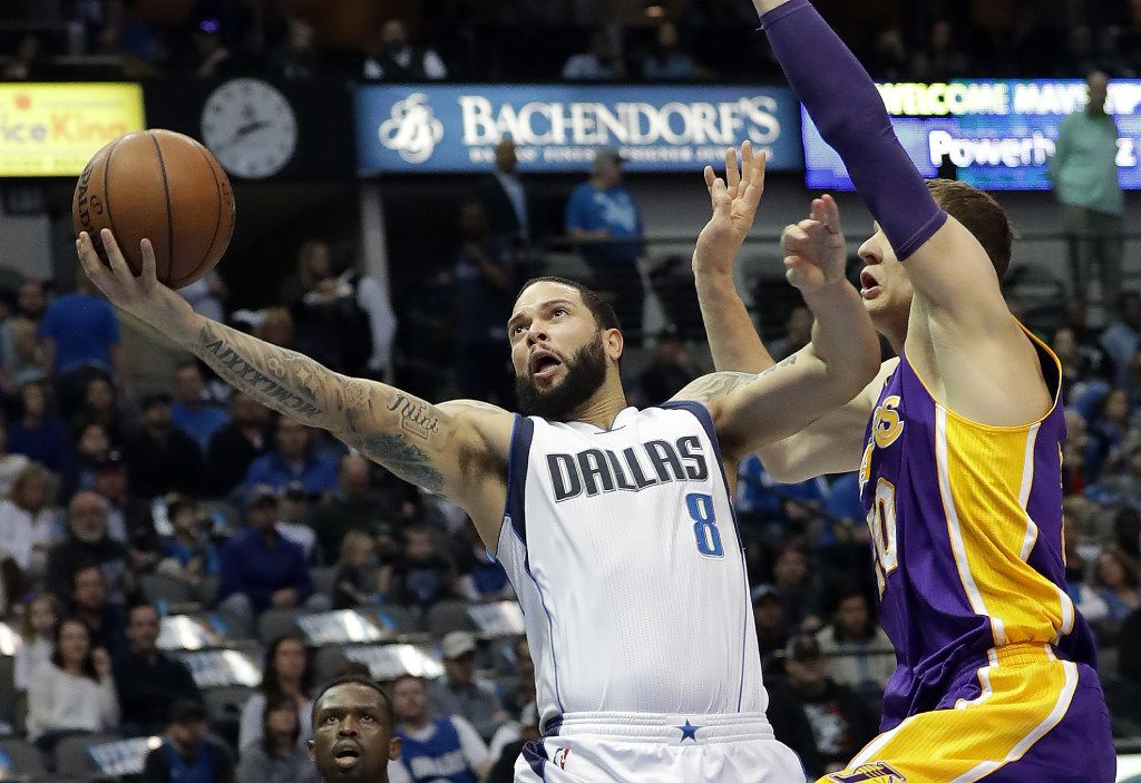 DALLAS, TX - JANUARY 22:  Deron Williams #8 of the Dallas Mavericks takes a shot against Timofey Mozgov #20 of the Los Angeles Lakers at American Airlines Center on January 22, 2017 in Dallas, Texas.  NOTE TO USER: User expressly acknowledges and agrees that, by downloading and or using this photograph, User is consenting to the terms and conditions of the Getty Images License Agreement.  (Photo by Ronald Martinez/Getty Images)