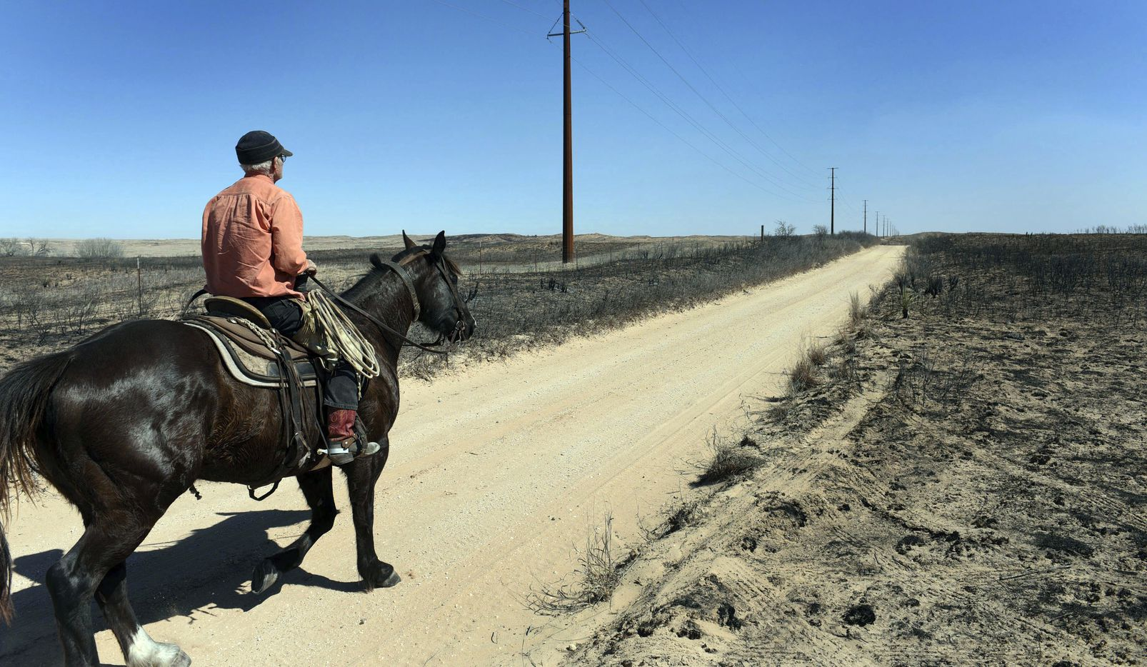 David Crockett said his grandson and friends got caught in a wind shift that blew the fire back on them, trapping them while herding cattle in a sandy dunes area of the ranch. (Michael Schumacher/Amarillo Globe-News)