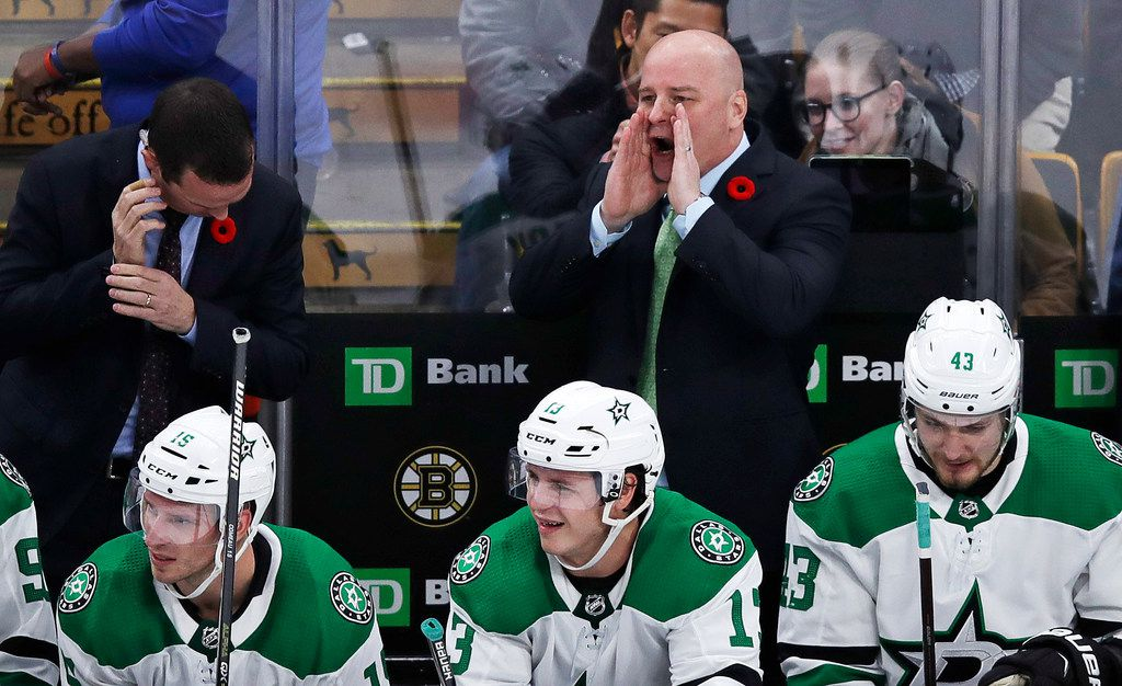 Dallas Stars head coach Jim Montgomery calls to his players during the overtime period of a hockey game against the Boston Bruins in Boston, Monday, Nov. 5, 2018. The Bruins defeated the Stars 2-1. (AP Photo/Charles Krupa)