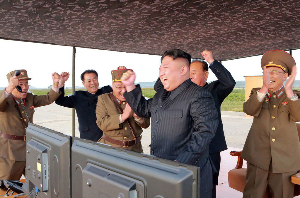 "This undated picture released from North Korea's official Korean Central News Agency (KCNA) on September 16, 2017 shows North Korean leader Kim Jong-Un (C) inspecting a launching drill of the medium-and-long range strategic ballistic rocket Hwasong-12 at an undisclosed location. Kim vowed to complete North Korea's nuclear force despite sanctions, saying the final goal of his country's weapons development is ""equilibrium of real force"" with the United States, state media reported on September 16."