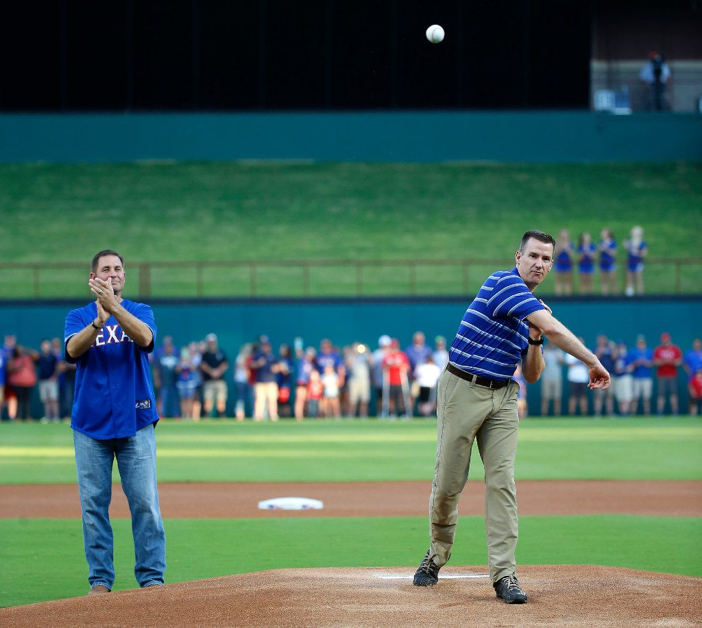 John Abbott (left), an El Centro College police officer, who was shot by Micah Johnson in the July 7th ambush shooting in Dallas, watches Arlington Police Chief Will Johnson throw the first pitch at the Rangers and Oakland Athletics game  at Globe Life Park in Arlington, Texas, Saturday, Sept. 17, 2016. (Jae S. Lee/The Dallas Morning News)