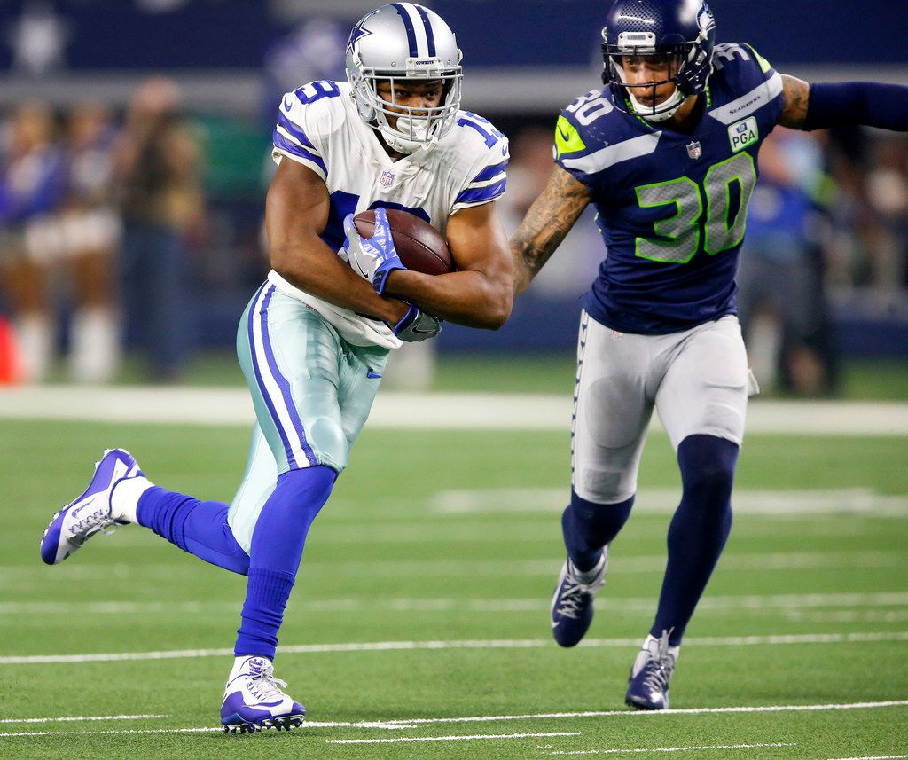 Cowboys wide receiver Amari Cooper (19) races downfield away from Seattle Seahawks strong safety Bradley McDougald (30) in the fourth quarter of  their NFC wild-card game at AT&T Stadium in Arlington on Saturday, Jan. 5, 2019. (Tom Fox/The Dallas Morning News)