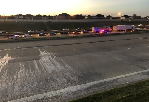 Ice covers part of the roadway along the President George Bush Turnpike on Tuesday morning in Irving.