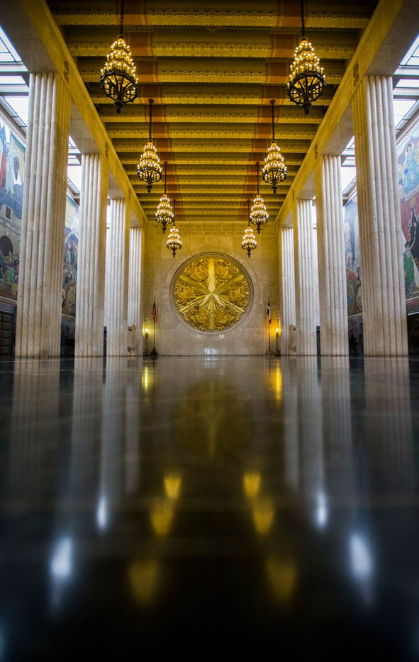 A large gold seal and murals decorate the inside of the historic Hall of State building on March 1, 2019 at Fair Park in Dallas. The building, originally built in 1936 ahead of the Texas Centennial Exposition, will soon begin a restoration.