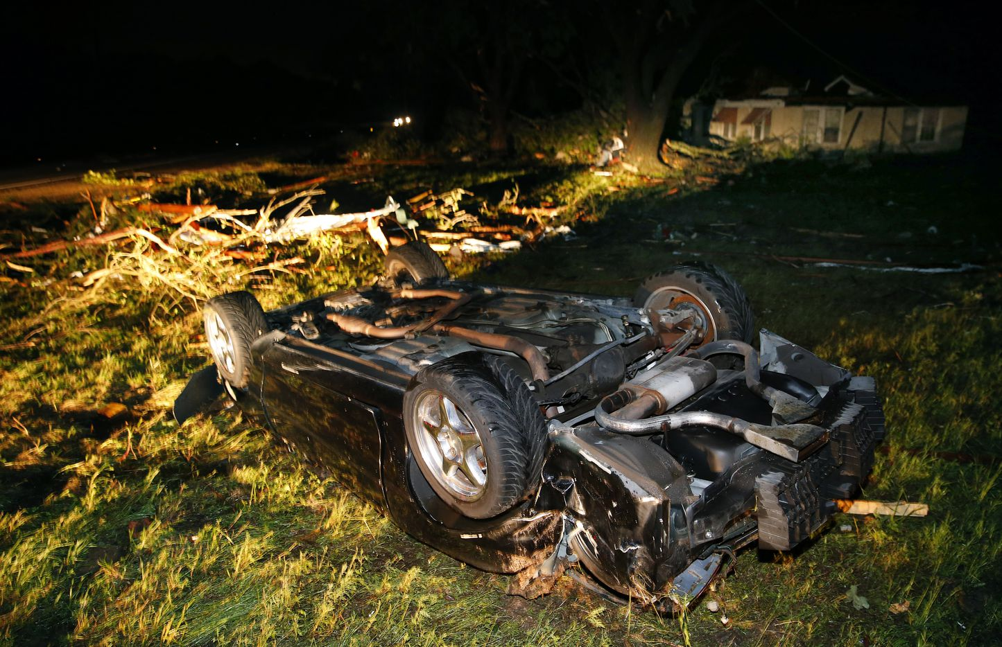 A car that barrel-rolled lies in an empty field along State Highway 80 in Fruitvale, Texas after a tornado swept through late Saturday, April 29, 2017. . (Tom Fox/The Dallas Morning News)