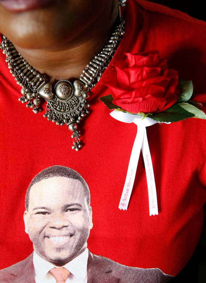 Chantal Antoine from the Justice for Botham Team wears a red carnation prior to the start of the funeral of Botham Shem Jean at Minor Basilica of the Immaculate Conception in Castries, St. Lucia on Monday, September 24, 2018. Jean was shot and killed in his apartment by off duty Dallas police officer Amber Guyger. (Vernon Bryant/The Dallas Morning News)