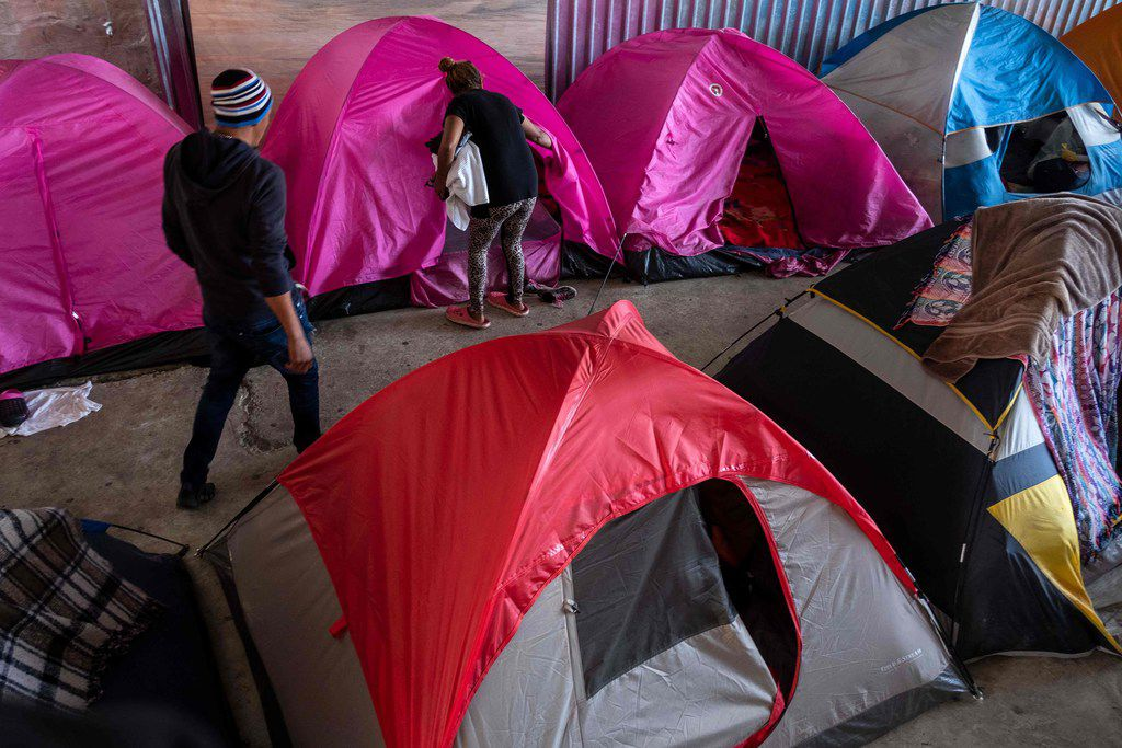 Migrants seeking for asylum in the United States are seen in Juventud 2000 migrant shelter in Tijuana, on March 5, 2019. - According to the US Customs and Border Protection, statistics observed more than a 300 percent increase in the number of family units apprehended compared to the same time period in 2018. (Photo by Guillermo Arias / AFP)GUILLERMO ARIAS/AFP/Getty Images