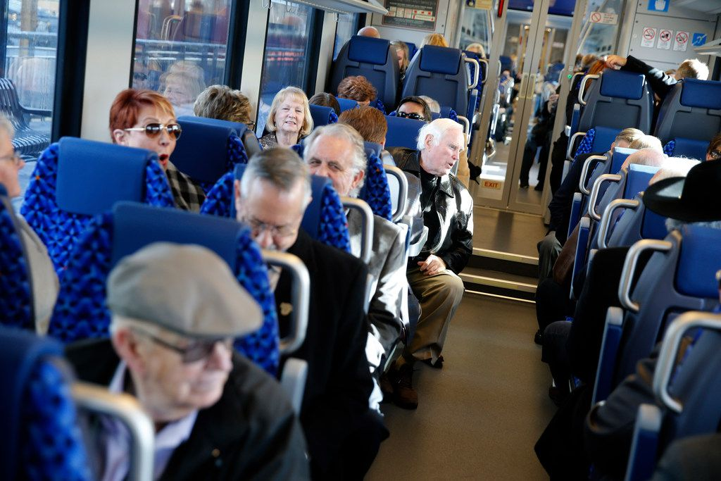 Travelers waited in their seats for a preview trip on Trinity Metro's TEXRail  to DFW Airport from the Grapevine/Main Street Station in Grapevine on New Year's Eve.