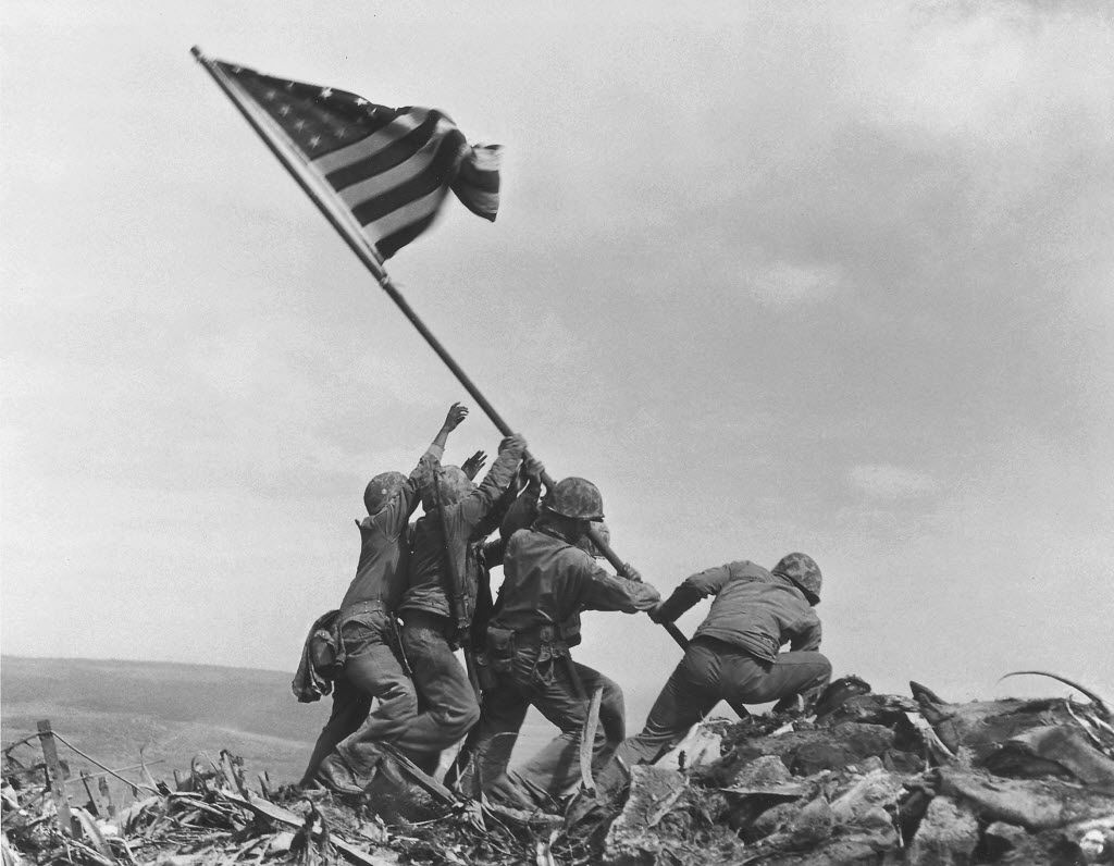 """The book includes some iconic photos, such as Joe Rosenthal's """"Raising the Flag on Iwo Jima,"""" while also devoting space to relatively unknown photographs."""