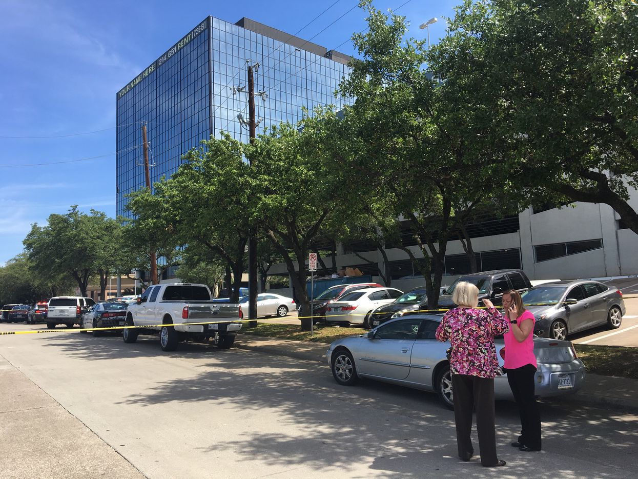 Workers stand outside at Lake Highlands office building where a shooting was reported Monday morning. (Jae S. Lee/Staff Photographer)