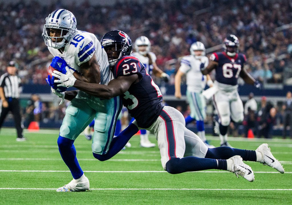 Dallas Cowboys wide receiver Ced Wilson (16) is tackled by Houston Texans defensive back Johnson Bademosi (23) during the second quarter of an NFL game between the Dallas Cowboys and the Houston Texans on Saturday, August 24, 2019 at AT&T Stadium in Arlington. (Ashley Landis/The Dallas Morning News)