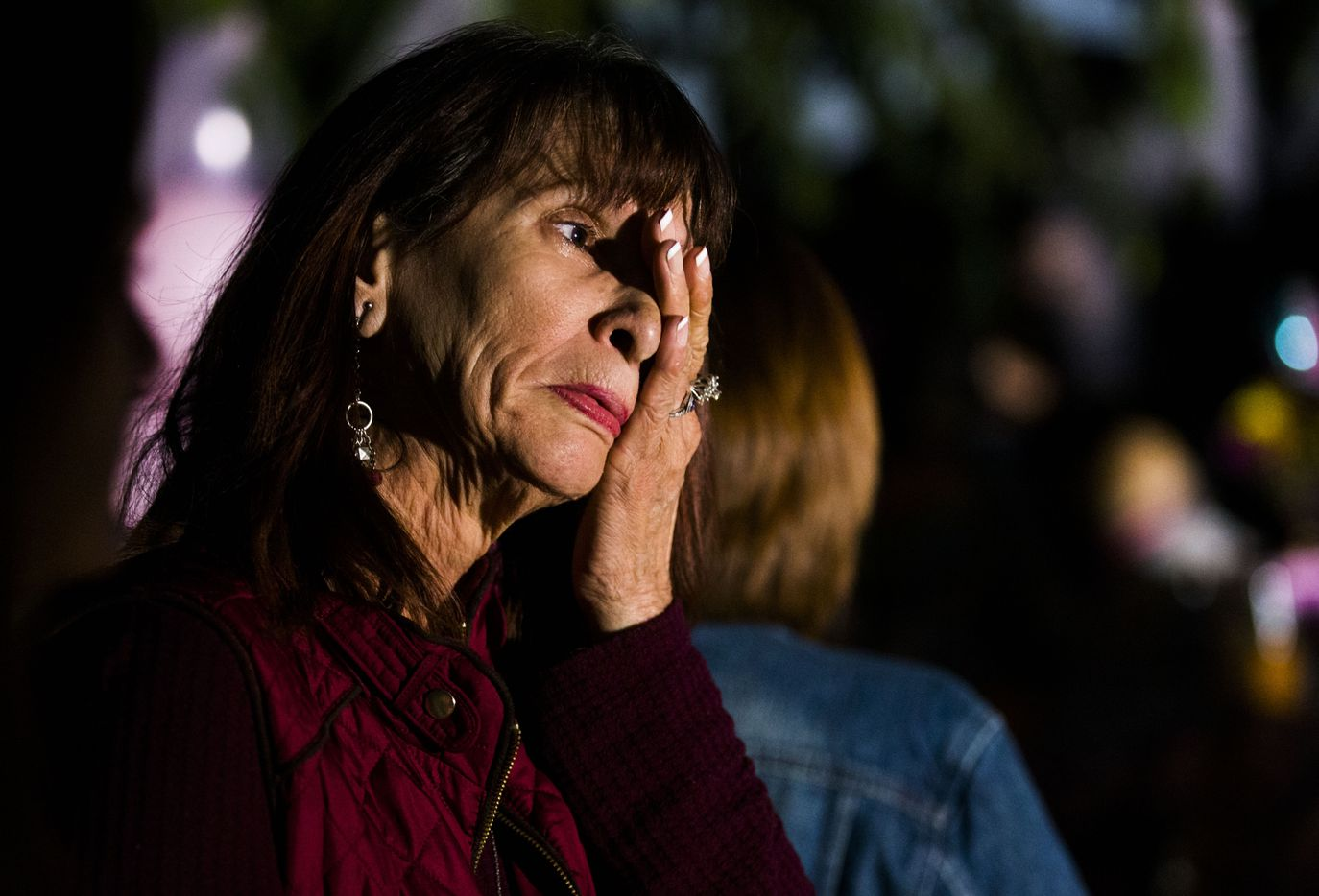 Linda Robinson wipes away a tear during a vigil for Sherin in Richardson.