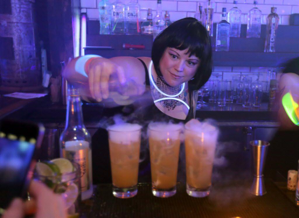Bartender Jen Keyser pours Dark & Foggy drinks at Henry's Majestic in December.