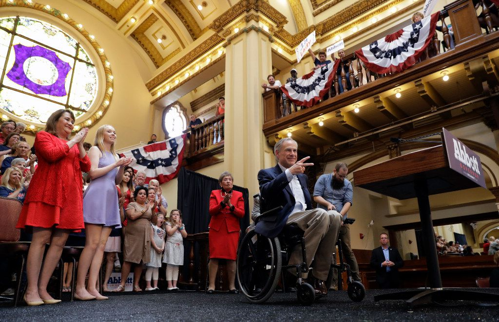 Texas Gov. Greg Abbott waves to supporters during an event where he announced his bid for re-election, Friday, July 14, 2017, in San Antonio. (AP Photo/Eric Gay)