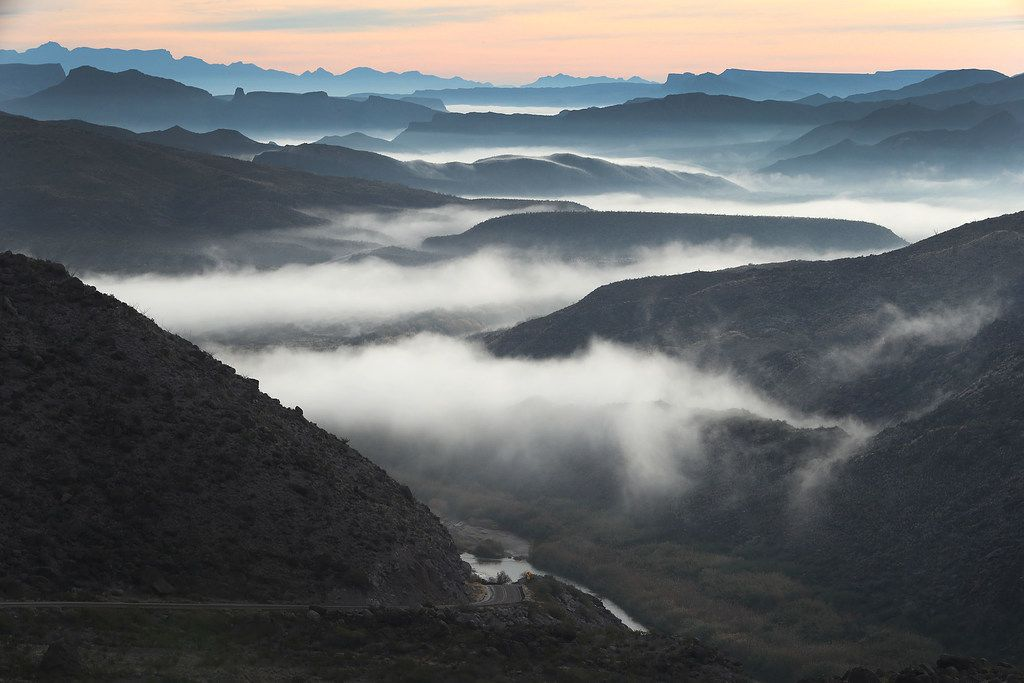 Fog blankets the valley over the Rio Grande river  (seen at the bottom center) that marks the boundary between the United States (to the left of the river ) and Mexico (to the right of the river).