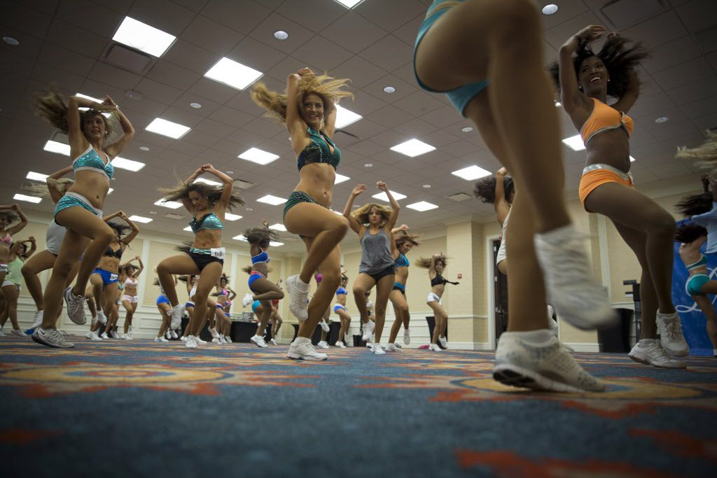 Participants rehearse, as a group, a dance number before facing judges during final auditions to join the 2015-2016 Dallas Mavericks Dancers team Sunday, July 12, 2015 in Dallas. More than 40 women made it to the finals, vying for a spot to take part in a training camp later in the week.
