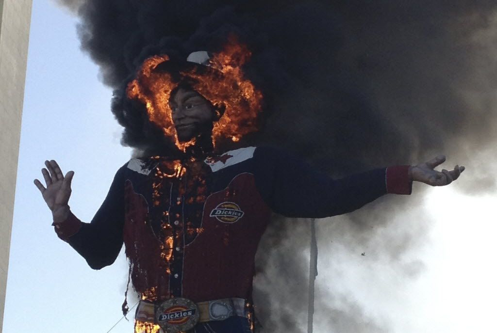 Fire engulfs Big Tex at the State Fair of Texas in Dallas on Friday, Oct. 19, 2012.