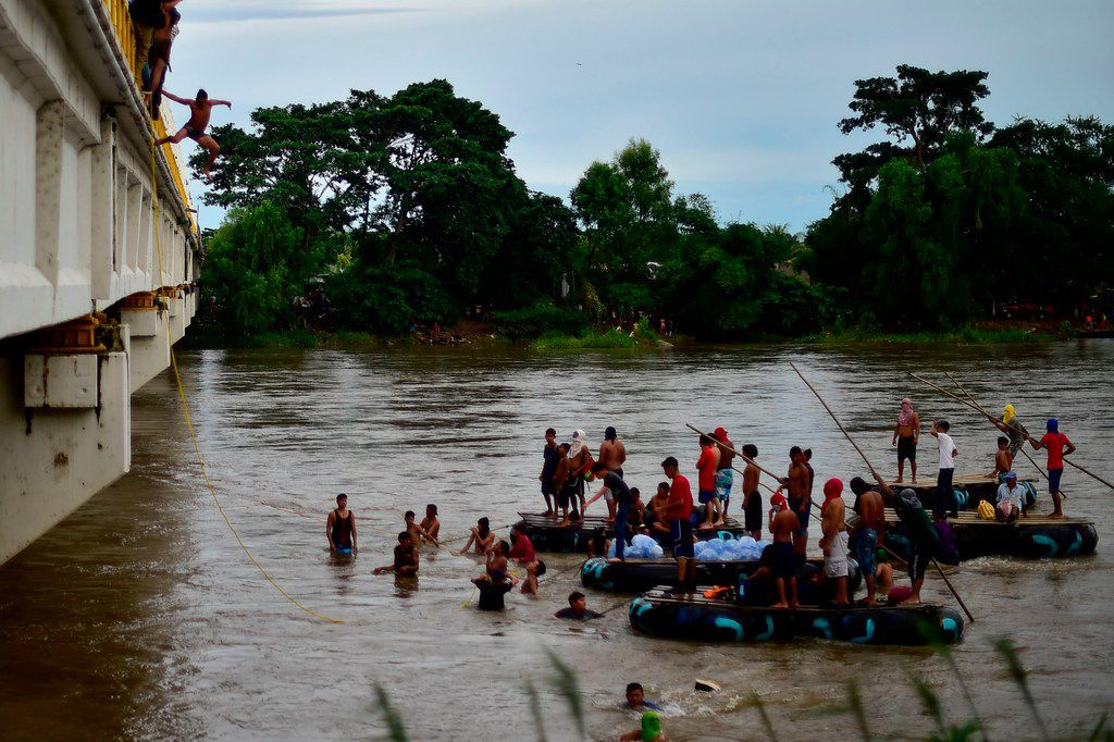 A Honduran migrant bound for the U.S. jumped from the Guatemala-Mexico border bridge into the Suchiate River on Friday to swim or board a raft to reach Mexico.
