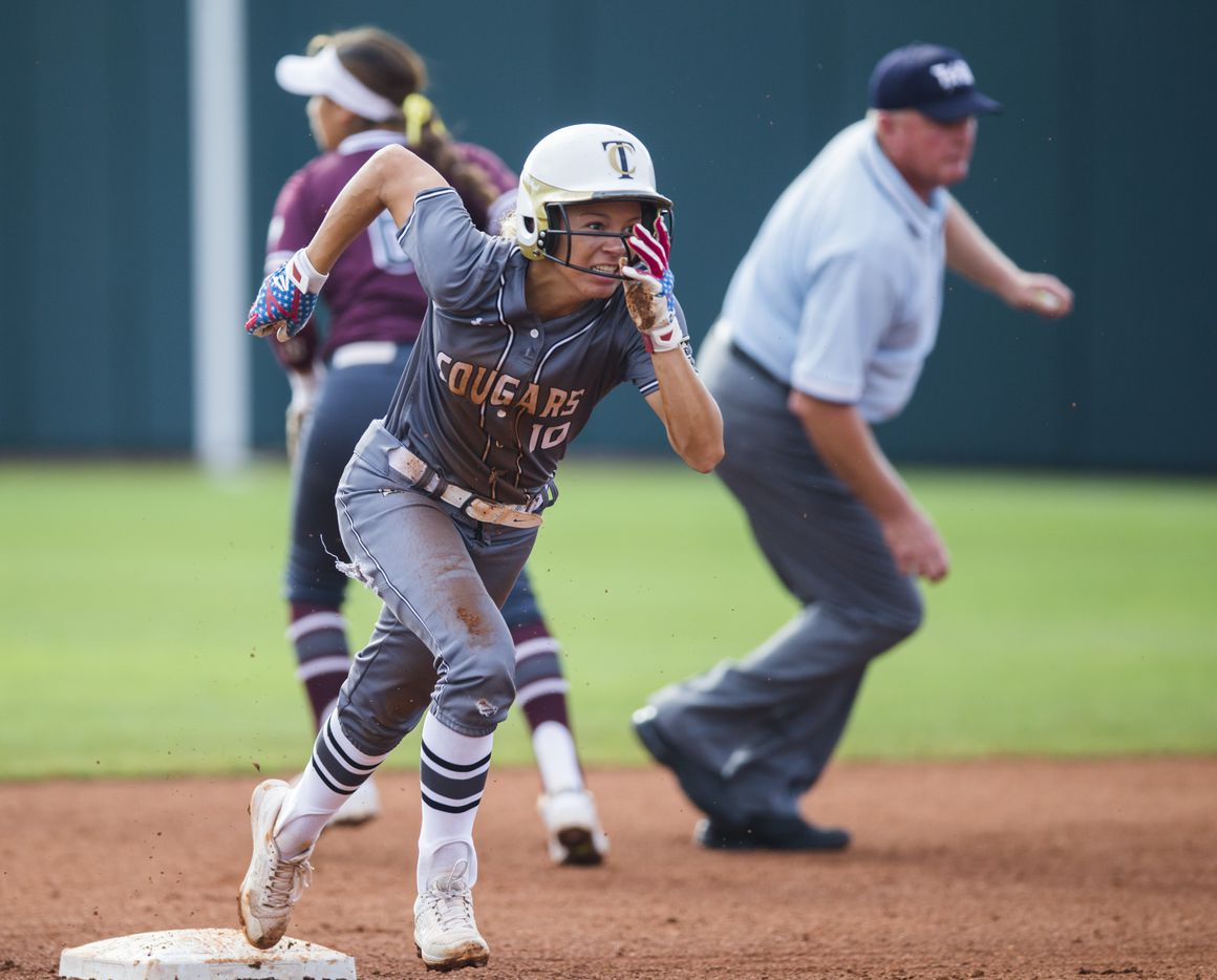The Colony's Jayda Coleman (10) runs to third base after a dropped throw to second base by  by Calallen's Katherine Flores (6) during the first inning of a UIL Class 5A state semifinal softball game between The Colony and Corpus Christi Calallen on Friday, May 31, 2019 at Red & Charline McCombs Field at the University of Texas in Austin. (Ashley Landis/The Dallas Morning News)