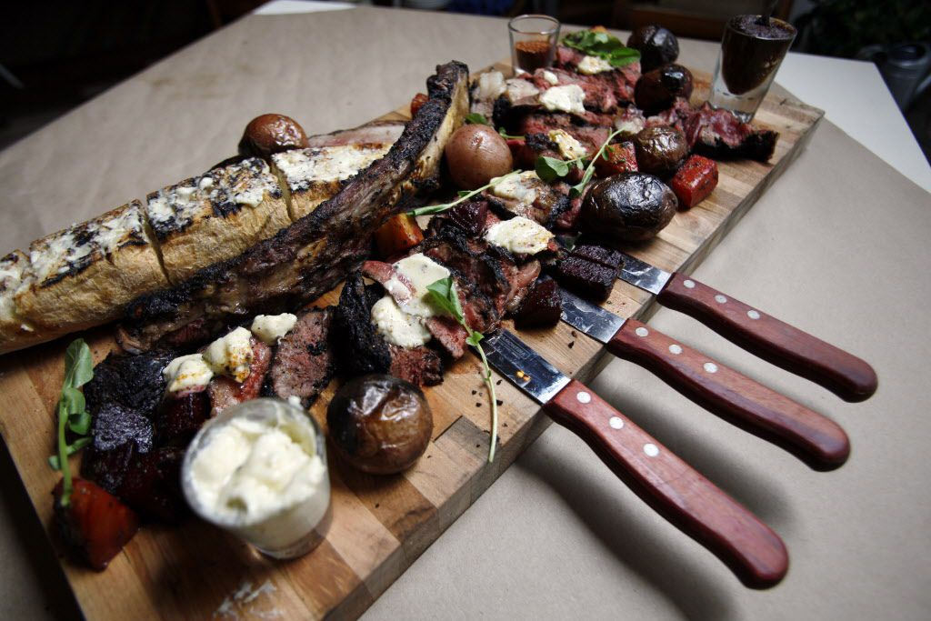"""The Eisenhower steak with smoked oxtail """"gentleman's relish,"""" horseradish,  blue cheese butter, grilled sourdough and hearth-roasted potatoes and beets"""