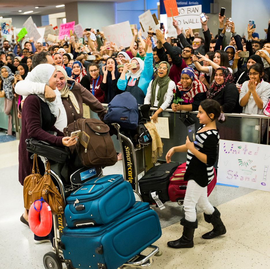 Motasim Abusaad of Irving hugs his sister Nancy Abusaad and his niece Zenna Jarrar as they arrive from Jordan at DFW International Airport on Sunday, Jan. 29, 2017.  (Smiley N. Pool/The Dallas Morning News)