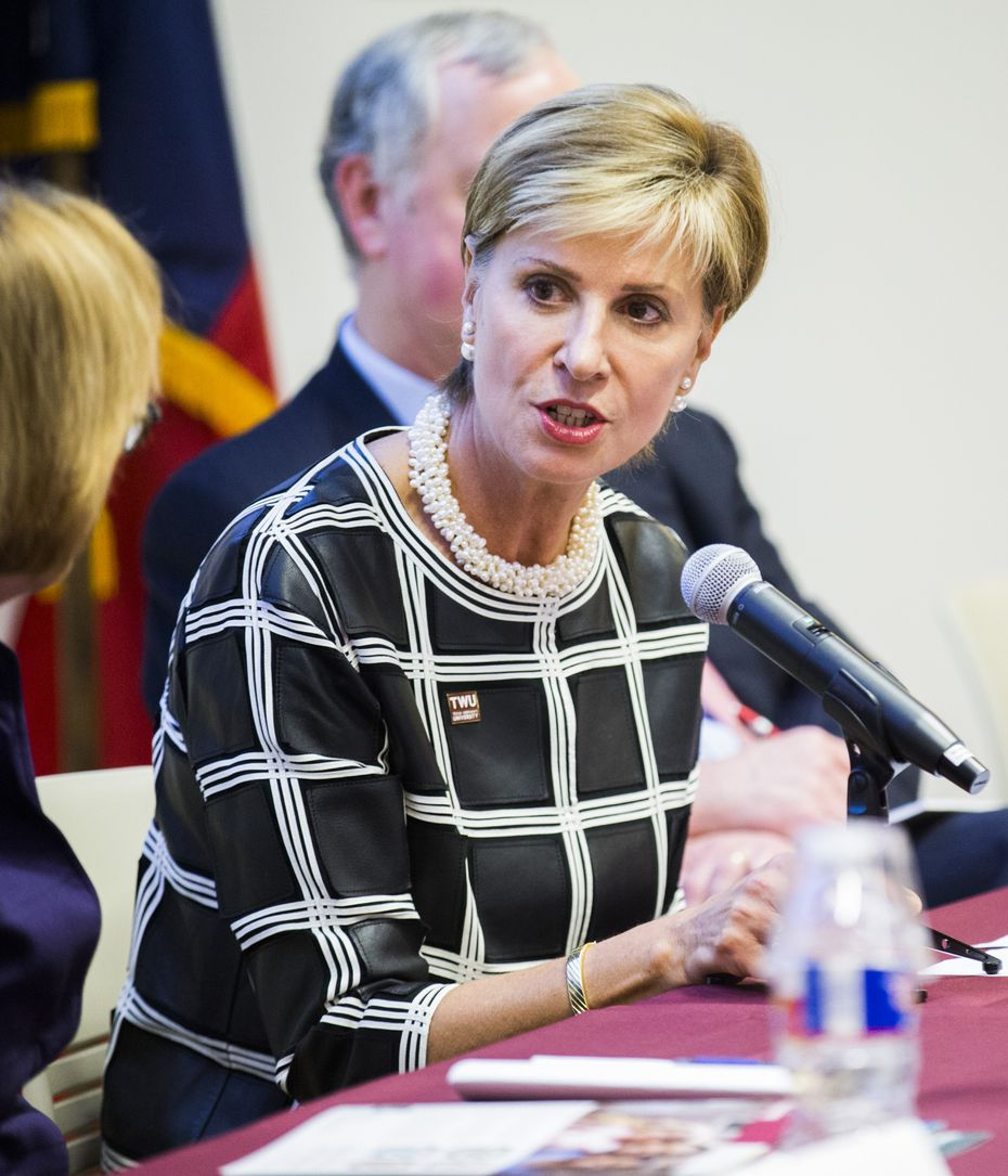 Carine Feyten, chancellor and president of Texas Woman's University, speaks on a panel as the Dallas Women's Foundation presents its Economic Issues for Women in Texas 2017 study. (Ashley Landis/Staff Photographer)