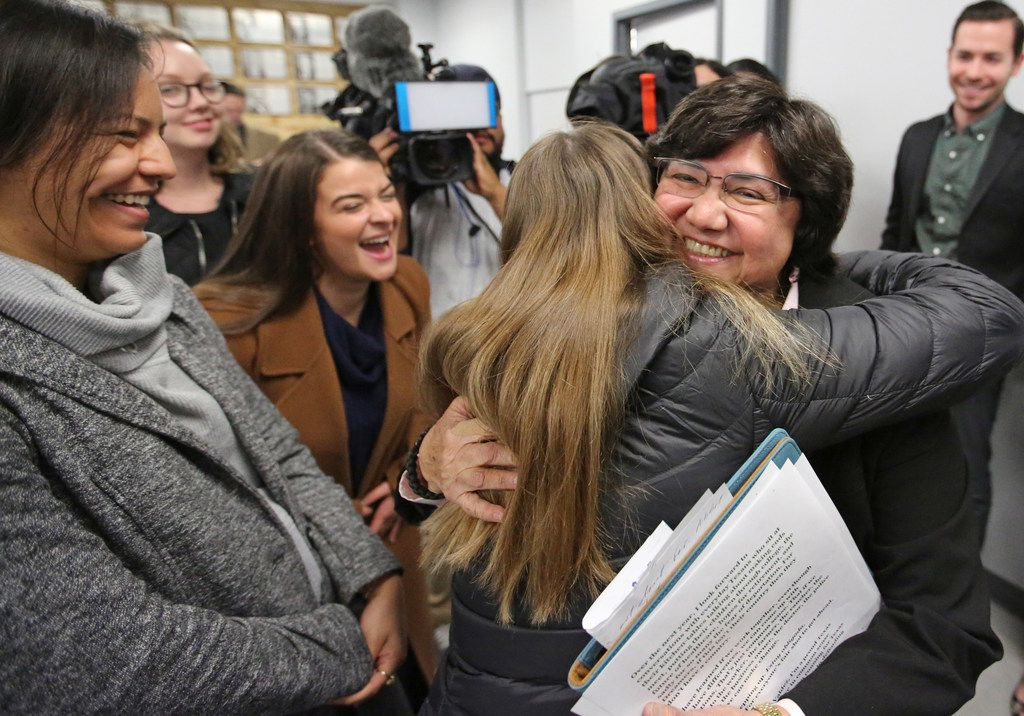 Former Dallas County Sheriff Lupe Valdez is hugged by well-wishers after her announcement that she will seek the Democratic nomination for Texas governor at a news conference in Austin on Dec. 6.