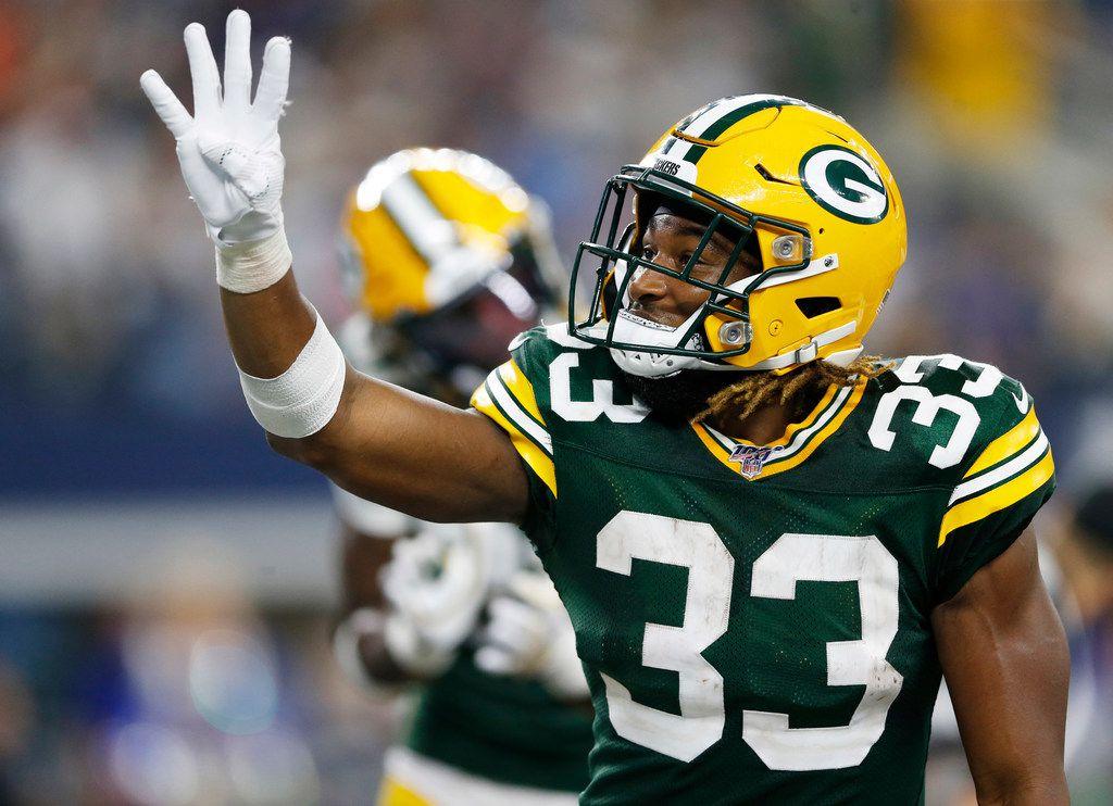 El corredor de los Green Bay Packers Aaron Jones (33) anotó cuatro touchdowns ante los Dallas Cowboys el domingo.
