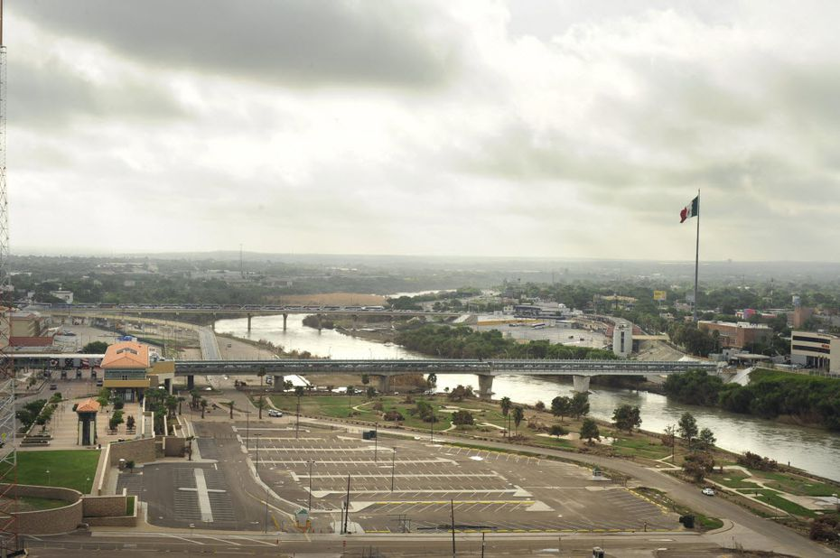 A bridge connects Laredo and Nuevo Laredo. Couriers for Mexican drug cartels are moving tens of billions of dollars in profits south across the border each year, a river of dirty money that has overwhelmed U.S. and Mexican customs agents.