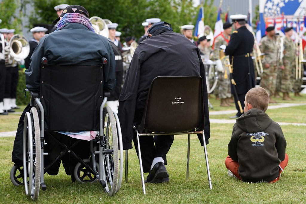A young boy sits with World War II veterans during a ceremony to mark the 75th anniversary of the D-Day landings on June 5 in Carentan, France. Veterans and families gathered in Normandy to commemorate D-Day's 75th anniversary. Overnight it was announced that 16 countries had signed a historic proclamation of peace to ensure the horrors of the Second World War are never repeated. The text has been agreed by Australia, Belgium, Canada, Czech Republic, Denmark, France, Germany, Greece, Luxembourg, Netherlands, Norway, New Zealand, Poland, Slovakia, the United Kingdom and the United States of America.