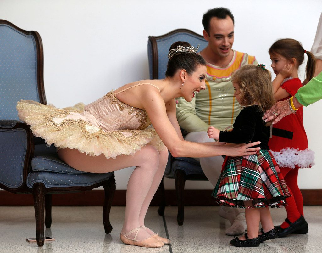 New York City Ballet principal dancers Tiler Peck and Tyler Angle greet Mary Kellerman, 2, after performing with Chamberlain Performing Arts students in The Nutcracker at the Eisemann Center in Richardson on Nov. 25.