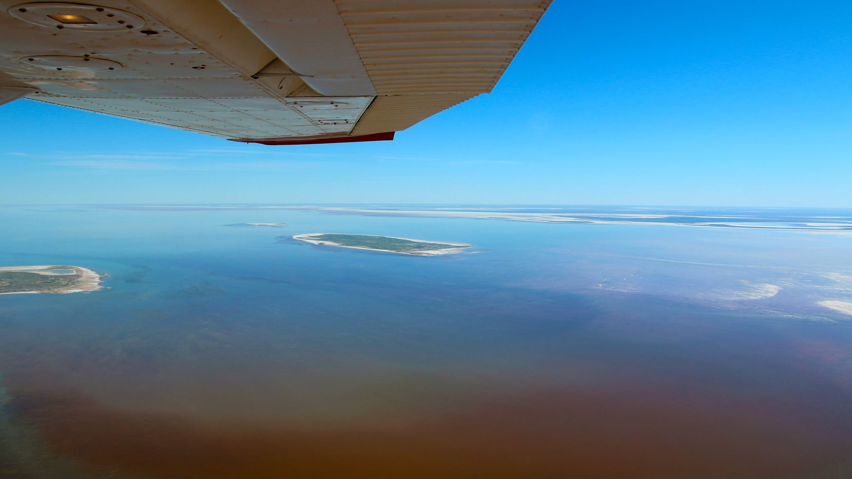 Kati Thanda-Lake Eyre in all its pastel-colored glory. The combination of water depth, ambient light and fish presence determines its ever-changing colors
