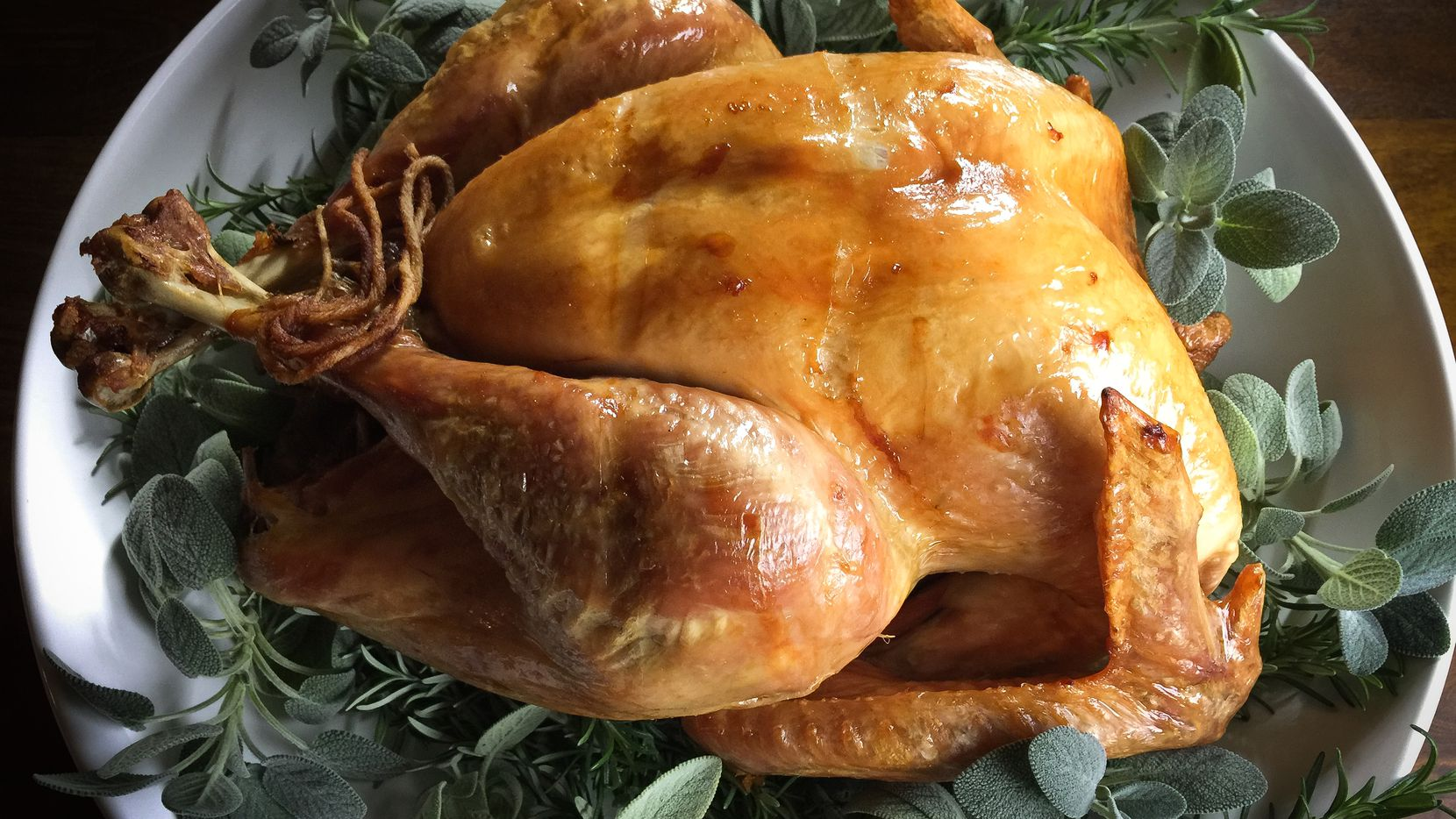 A dry-brined roasted turkey, served with Cognac sauce (not gravy!), is the centerpiece of Leslie Brenner's Thanksgiving dinner.