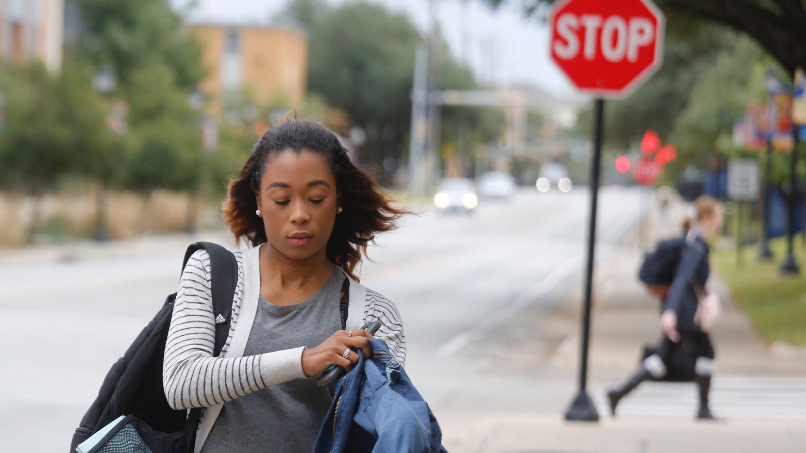 Hayley Woolen, a freshman at UT-Arlington, put on her jacket as she walked across the Arlington campus last year.