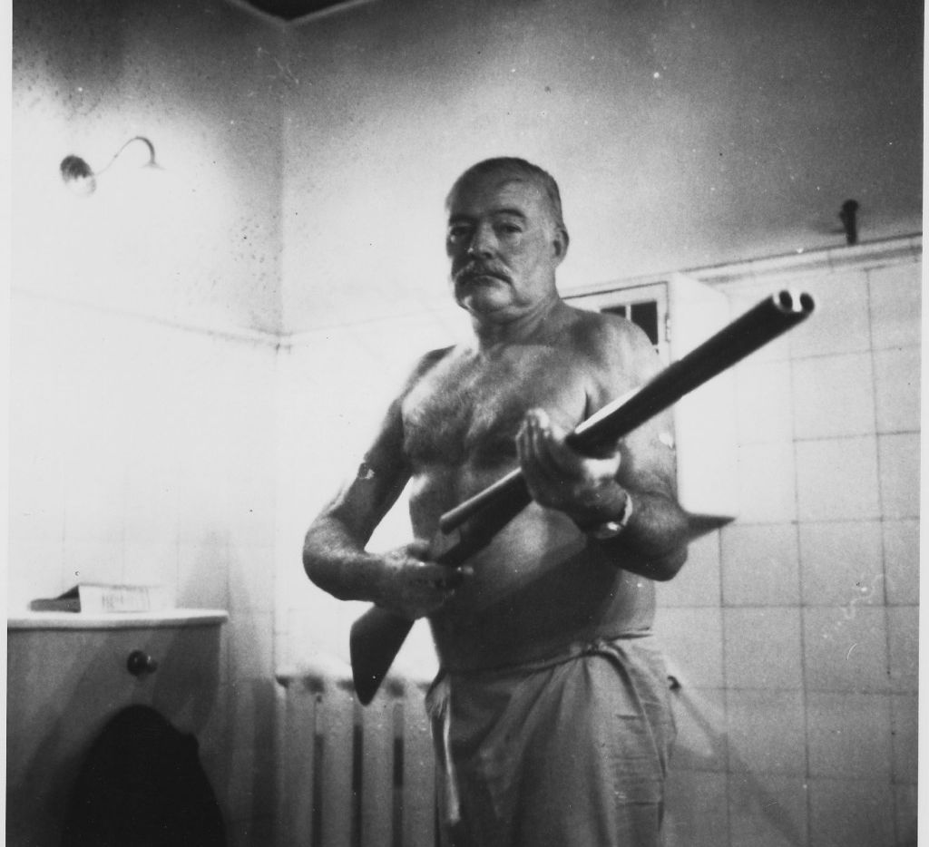 """Ernest Hemingway on guard at Finca Vigia, his home outside Havana. The Cuban Revolution led him to fear looters and kidnapping. From """"Writer, Sailor, Soldier, Spy,"""" by Nicholas Reynolds."""