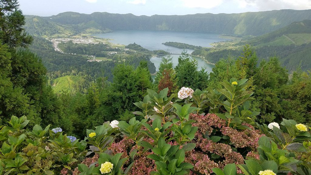 Sete Cidades, a three-mile-wide volcanic crater filled with lakes and a village, is the most photographed site in the Azores, as seen from Vista do Rei on Sao Miguel Island.