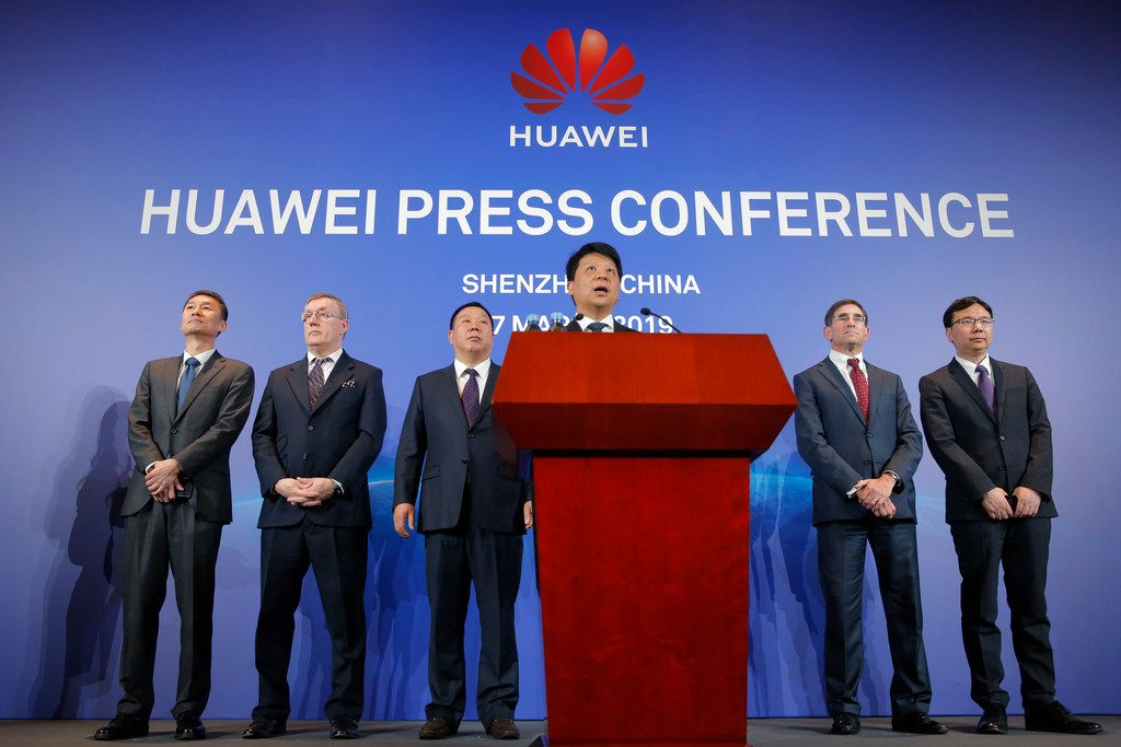 Huawei Rotating Chairman Guo Ping, center, speaks in front of other executives during a press conference in Shenzhen, China.