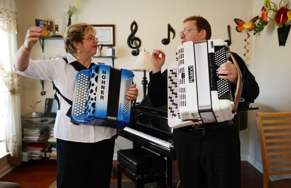 Elena and Gregory Fainshtein let their final note sound after playing a song on the accordion in their Plano home.