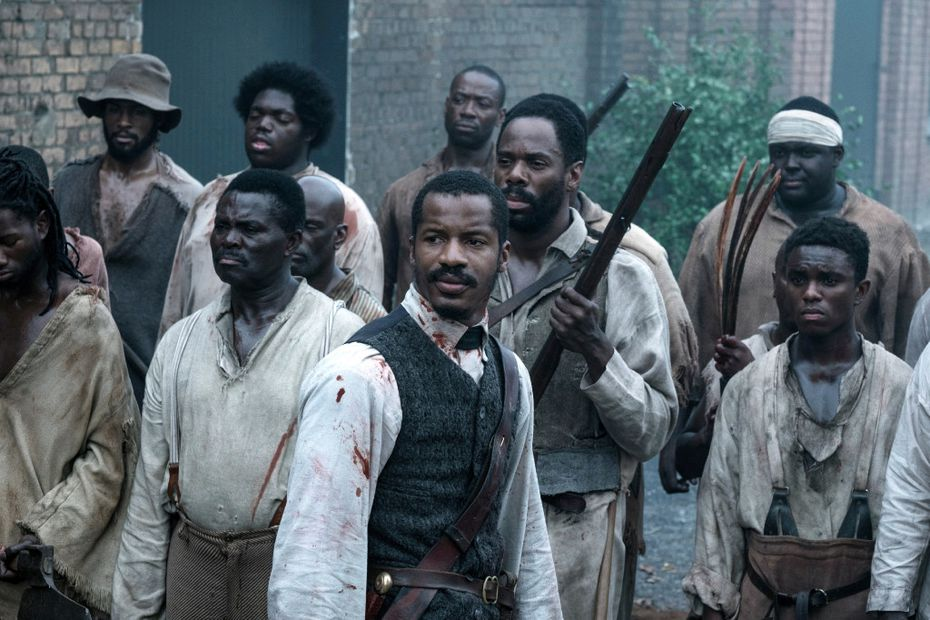 """Nate Parker (center) plays Nat Turner  in a """"The Birth of a Nation."""""""