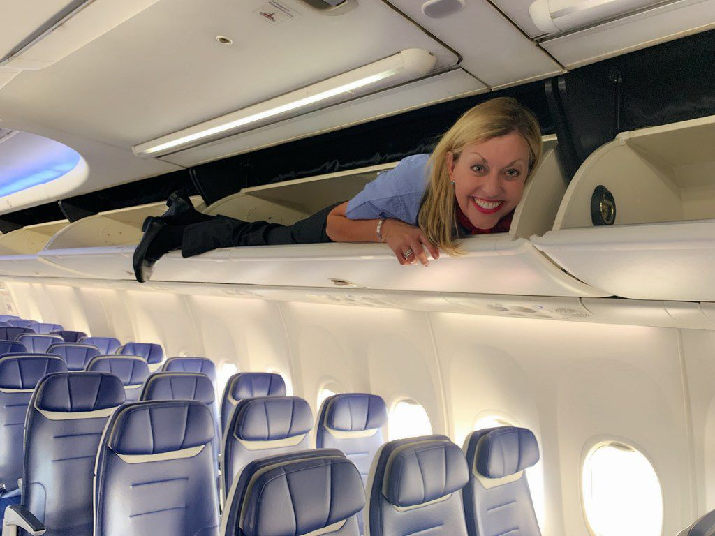 Shari Rood marked her first official day as a flight attendant at Southwest Airlines by climbing into the overhead bin before passengers in Ontario boarded their flight to Oakland, Calif. The 56-year-old mother of four grown daughters just got her wings after 35 years in Southwest's customer service department at Phoenix Sky Harbor International Airport.