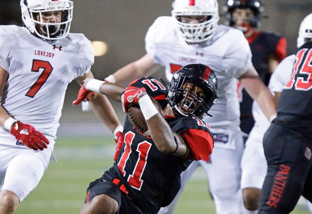 Colleyville Heritage High School defensive back Josh Ford Dobbins (11) returns an interception to stop a drive during the second half as Colleyville Heritage High School hosted Lovejoy High School as part of the Tom Landry Classic at Eagle Stadium in Allen on Saturday, August 31, 2019. (Stewart F. House/Special Contributor)