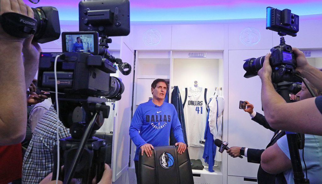 Dallas Mavericks owner Mark Cuban talks with the media in front of Dirk Nowitzki's locker during the unveiling of the MavericksÕ new state-of-the-art locker room, training facility and office space at the American Airlines Center in Dallas on Saturday, September 30, 2017. (Louis DeLuca/The Dallas Morning News)