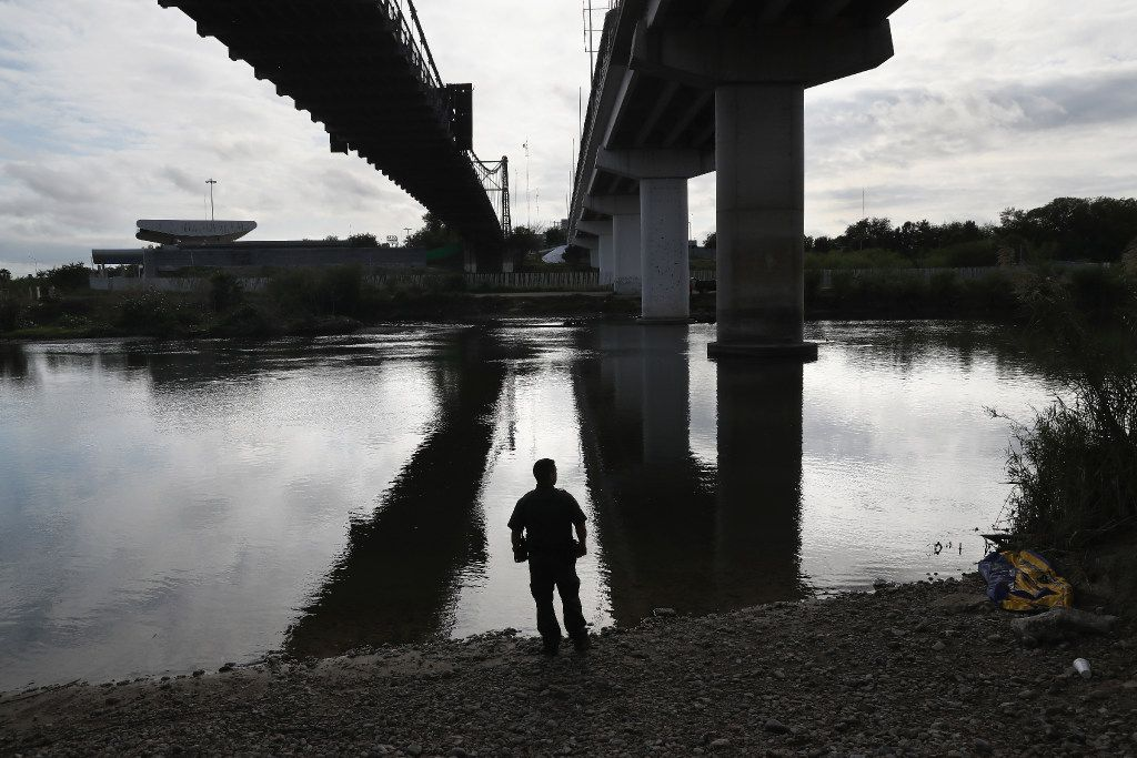 ROMA, TX - MARCH 13:  A U.S. Border Patrol agent looks into Mexico from the bank of the Rio Grande on March 13, 2017 in Roma, Texas. The Border Patrol has reported that illegal crossings from Mexico have dropped some 40 percent along the southwest border since Donald Trump took office.  (Photo by John Moore/Getty Images) *** BESTPIX ***